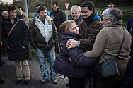Gotzone Lopez de Luzuriaga embraces friends who were waiting for her, as she gets out of Martutene prison. Donostia (Basque Country) November 26, 2013. Gotzone is one of the imprisoned members of the armed Basque separatist group ETA  who's release was ordered by the Spanish National Court,  after a European rights ruling that is opening the jail doors for dozens of the militants (Gari Garaialde /Bostok Photo)