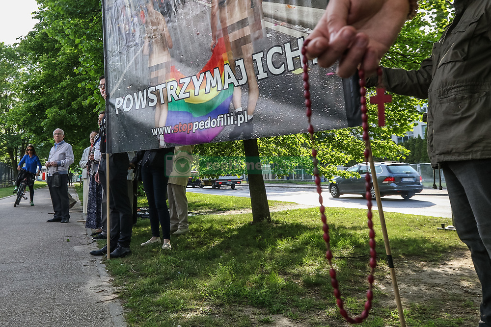 May 24, 2019 - Gdansk, Poland - People holding banner that says - They want to teach your children - STOP them! '' with rosary in hands and praying in front of Gdansk University are seen in Gdansk, Poland on 24 May 2019 Far right activists, Catholic fanatics and so called pro-life activists organised public prayers on Gdansk University against - as they say -homosexual propaganda and supporting by the University authorities LGBT students. (Credit Image: © Michal Fludra/NurPhoto via ZUMA Press)