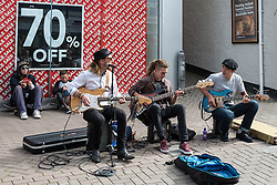 Musicians from the band, The Big Sets entertain holidaymakers in Newquay, Cornwall.