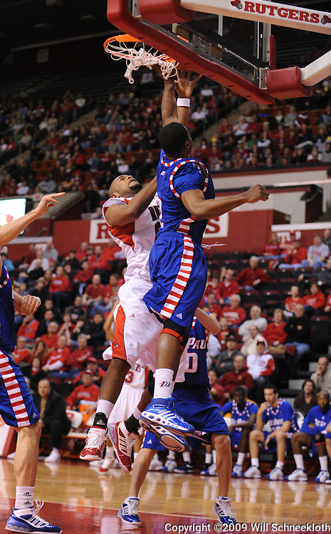 Jan 31, 2009; Piscataway, NJ, USA; Rutgers forward Gregory Echenique (00) puts a shot up over the reach of DePaul forward Dar Tucker (2) during the first half of Rutgers' 75-56 victory over DePaul in NCAA college basketball at the Louis Brown Athletic Center