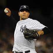 Dellin Betances, New York Yankees, makes a wild throw to fist base during the New York Yankees Vs Cincinnati Reds baseball game at Yankee Stadium, The Bronx, New York. 18th July 2014. Photo Tim Clayton