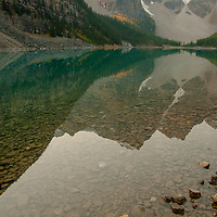 Mounts Babel, Bowlen, Tonsa & Perren reflect in Moraine Lake in Banff National Park, Alberta, Canada.