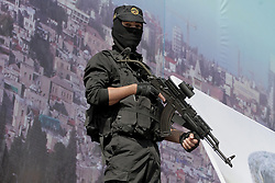 October 21, 2016 - Gaza, Gaza Strip, Palestinian Territory - A Palestinian Islamic Jihad militant stands guard during a rally marking the 29th anniversary of the movement foundation in Gaza City October 21, 2016  (Credit Image: © Abed Rahim Khatib/APA Images via ZUMA Wire)