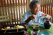 """At a """"longevity restaurant"""", an eatery claiming to serve food that will make patrons live longer, in Ogimi, Okinawa, 96-year-old Matsu Taira finishes the long-life lunch with a jellied fruit dessert made from bright-red acerola berries. Hungry Planet: What the World Eats (p. 192)."""