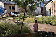 Casolina Gypsy camp near a military airport inside Rome. Roma Gypsies victims of racism and discrimination, often forcibly evicted or moved from one camp to another, marginalized, living on the periphery of urban centres. The Roma Gypsies originated from India where they left over a thousand years before. Tribes moved across Euroasia eventually arriving in Europe in the 14th century. They have survived 500 years of slavery and persecution. They moved from place to place, often nomadic in search of work. Now many live in container camps, some are unemployed, others work the markets, or import export. Rome, Italy.