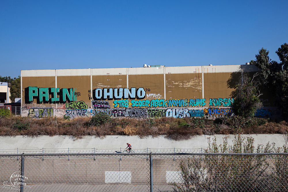 Recent graffiti on side of office building, Culver City, California, USA
