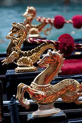 Ornate golden decorations on gondolas in Venice Italy