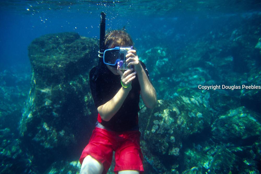 Boy swimming, Hawaii<br />