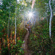 Heather Goodrich rides the singletrack on the Putt Putt Trail across the valley from Snow King Ski Area near Jackson, Wyoming.