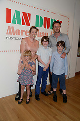 JEMIMA DURY daughter of Ian Dury and JAPHY TURNER with their children (l-r) BETTY TURNER, MILO TURNER and GENE TURNER at a private view of the late Ian Dury's artwork entitled Ian Dury: More Than Fair – Paintings, drawings and artworks, 1961–1972 held at the Royal College of Art, Kensington Gore, London SW7 on 22nd July 2013.