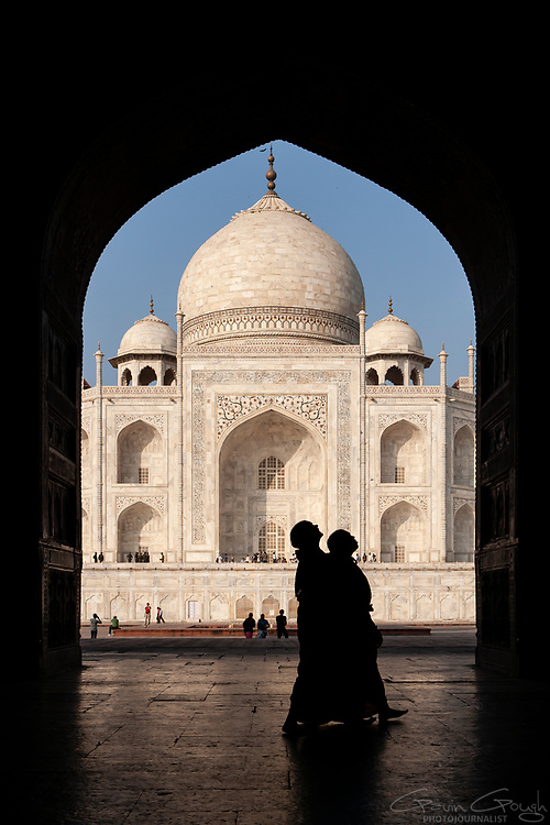 Silhouette of two women looking up at an arch, Taj Mahal, Agra, India
