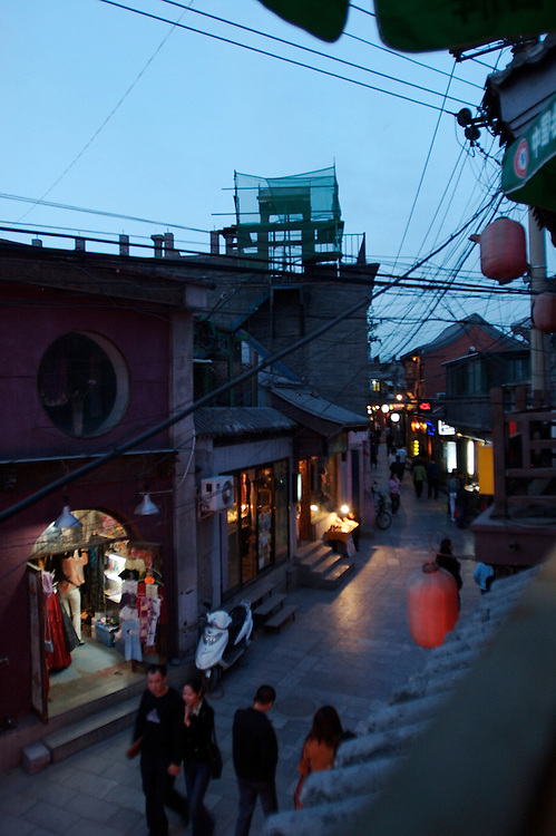 A hutong or alleyway in the Shichahai area in Beijing,China.  Shichahai has retained the old style structures and hutongs and is a popular section attracting both tourists and locals.