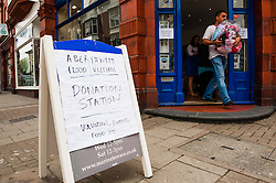 © Licensed to London News Pictures. 10/06/2012. Aberystwyth, UK Alexanders Estate Agents in Aberystwyth Wales UK operating as an emergency 'Donation Station' for people to bring clothes , bedding and other equipment for those  made homeless by the flash floods that hit the west wales area on Saturday 9 June 2012. Photo credit : Keith Morris/LNP
