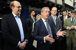 © Licensed to London News Pictures. 11/10/2014<br />   Nigel Farage talking in Rochester,Kent outside UKIP shop 30 Rochester High Street with UKIP MP Douglas Carswell and Mark Reckless.<br /> UKIP Leader Nigel Farage  in Rochester today (11.10.2014)with Mark Reckless and new UKIP MP for Clacton Carswell.<br /> (Byline:Grant Falvey/LNP)