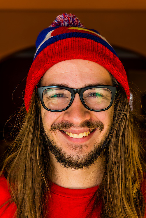 A before picture of a 24 year old man before having an extreme haircut, including cutting off a long ponytail for charity. Littleton, Colorado USA.