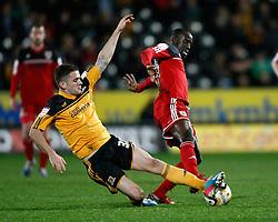 Bristol City's Albert Adomah is tackled by Hull's Robbie Brady- Photo mandatory by-line: Matt Bunn/JMP  - Tel: Mobile:07966 386802 19/04/2013 - Hull City v Bristol City - SPORT - FOOTBALL - Championship -  Hull- KC Stadium