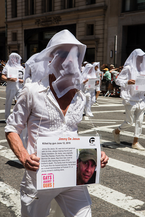 New York, NY - 25 June 2017. New York City Heritage of Pride March filled Fifth Avenue for hours with groups from the LGBT community and it's supporters.Marchers from Gays Against Guns dressed in white, with white veils over their heads, each bearing a card with the name, photograph, and history of a young gay or lesbian killed by guns. Commemorated by this marcher is Jimmy De Jesus, killed in the Pulse nightclub.