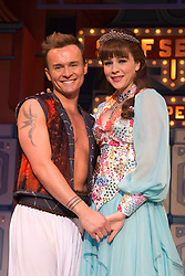 """© Licensed to London News Pictures. 11/12/2012. London, England. L-R: on Lee as Aladdin and Marissa Dunlop as Princess Jasmine. Lily Savage, aka Paul O'Grady, stars as the Widow Twankey in the Christmas panto """"Aladdin, A Wish Come True"""" at the Theatre at the O2, O2 Arena, London. Photo credit: Bettina Strenske/LNP"""