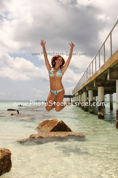Female European Tourist on the Caribbean island of Grand Turk