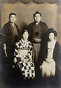 group photo of sumo wrestler with a supportive family early Japan 1930s