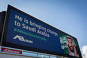 On the first day of his official 3-day visit to London, the face of Saudi Crown Prince Mohammed bin Salman appears on a large billboard on West Cromwell Road, on 7th March 2018, in London England. Industry sources said the Saudis could be spending close to £1m on the campaign, which includes dozens of prime poster sites around London and newspaper ads. He is bringing change to Saudi Arabia, the ads say, with a large photo of Crown Prince Mohammed bin Salman and the hashtag #ANewSaudiArabia.