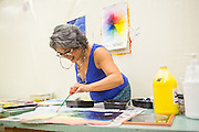 Painting teacher Irene Hentschke demonstrates using a paint brush during Milpitas High School's Back to School Night at Milpitas High School in Milpitas, California, on September 1, 2015. (Stan Olszewski/SOSKIphoto)