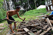 A staff chops wood at Brown's Field, Isumi, Chiba Prefecture, Japan, August 8, 2009.The organic farm introduces healthy and sustainable living in the Japanese countryside. It is staffed by the Brown family and volunteers from around the world.