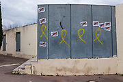 "Pro-Catalan independence graffiti and stickers, on the wall of the Biblioteca Central Gabriel Ferrater (municipal library) Sant Cugat del Valles, Barcelona, Catalonia.<br /> ""Llibertat Presos Politics"" is Catalan for ""free political prisoners"", while the yellow ribbon signifies solidarity with the politicians and civic leaders who were held, or are being held in Spanish prisons.  One resident of Sant Cugat, Catalan Foreign Minister Raul Romeva, was amongst those jailed."