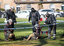 © Licensed to London News Pictures. 17/04/2021. Windsor, UK. Members of a police search team perform security searches in a drain on The Long Walk, next to Windsor Castle, in Windsor, Berkshire, ahead of the funeral of Prince Philip, The Duke of York. Prince Philip, the Consort of the longest reigning English monarch in history, Queen Elizabeth II, died on 9 April 2021, two months before his 100th birthday. . Photo credit: Ben Cawthra/LNP