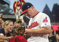 October 5, 2017 - Cleveland, OH, UKR - Cleveland Indians right fielder Jay Bruce signs autographs prior to the start of the team's game against the New York Yankees in Game 1 of the American League Division Series on Thursday, Oct. 5, 2017, at Progressive Field in Cleveland. (Credit Image: © Leah Klafczynski/TNS via ZUMA Wire)