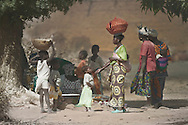 A group of women and children gathered on shore of the Niger river, Mali