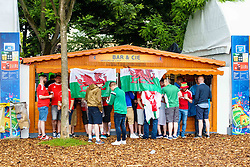 Wales fans shelter from the rain in the Paris Fanzone. Images from the UEFA EURO 2016, 14 June 2016. (c) Paul Roberts   Edinburgh Elite media. All Rights Reserved