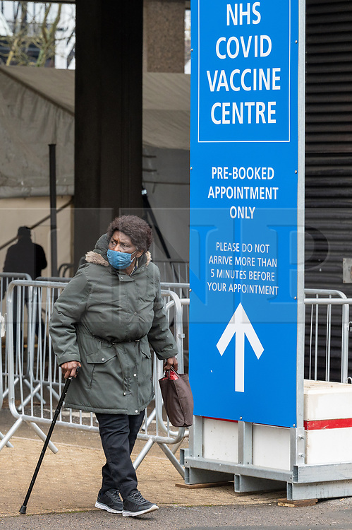 © Licensed to London News Pictures. 26/01/2021. London, UK. People leave the Olympic Office Centre, near Wembley Stadium after receiving the Covid-19 vaccination jab. Today the Office for National Statistics (LNS) today revealed as of January 15 there had been 103,704 Covid deaths. Photo credit: Ray Tang/LNP