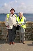 UK, Penzance - Monday, March 23, 2009: Anne and Brian Horrell pose for a photograph before the bells are loaded on to Gry Maritha, the Scilly Steamship Company's supply vessel, for transportation to St Mary on the Isles of Scilly. (Image by Peter Horrell / http://www.peterhorrell.com)