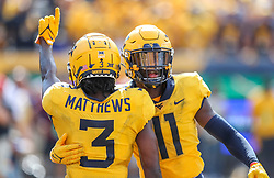 Sep 18, 2021; Morgantown, West Virginia, USA; West Virginia Mountaineers cornerback Jackie Matthews (3) and West Virginia Mountaineers cornerback Nicktroy Fortune (11) celebrate after a stop late in the fourth quarter against the Virginia Tech Hokies at Mountaineer Field at Milan Puskar Stadium. Mandatory Credit: Ben Queen-USA TODAY Sports
