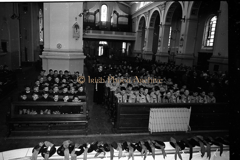 20/01/1963<br /> 01/20/1963<br /> 20 January 1963<br /> CBSI Investiture at Merchants Quay, Dublin. Investiture of 52 Scouts and 30 Macoimh, and presentation of 4 commissions to Scout Masters at the Franciscan Church. View of scouts seated in the church at the ceremony, note the organ in background and berets and scarves in foreground.