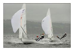 470 Class European Championships Largs - Day 2.Wet and Windy Racing in grey conditions on the Clyde...CRO83, Sime FANTELA, Igor MARENIC and GRE1, Antonis TSIMPOUKELIS, Pavlos KAGIALIS '.