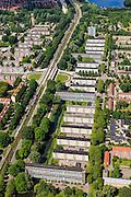 Nederland, Noord-Holland, Amsterdam, 14-06-2012; Slotervaart met de Cormelis Lelylaan en de flats aan de Comeniusstraat. In het midden de kruizing met de Johan Huizingalaan, boven in beeld de Sloterplas.De buurt is onderdeel van de Westelijke Tuinsteden, gerealiseerd op basis van het Algemeen Uitbreidingsplan voor Amsterdam (AUP, 1935). Voorbeeld van het Nieuwe Bouwen, open bebouwing in stroken, langwerpige bouwblokken afgewisseld met groenstroken. .This residential area (Slotervaart) is an example of garden cities of Amsterdam-west. Constructed on the basis of the General Extension Plan for Amsterdam (AUP, 1935). Example of the New Building (het Nieuwe Bouwen), detached in strips, oblong housing blocks alternated with green areas, built in fifties and sixties of the 20th century. Recreational lake (SLoterplas) top picture..luchtfoto (toeslag), aerial photo (additional fee required).foto/photo Siebe Swart