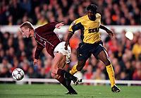 Lauren (Arsenal) Jiri Jarosik (Sparta Pargue). Arsenal 4:2 Sparta Prague, UEFA Champions League, Group B, 25/10/2000. Credit Colorsport / Stuart MacFarlane.