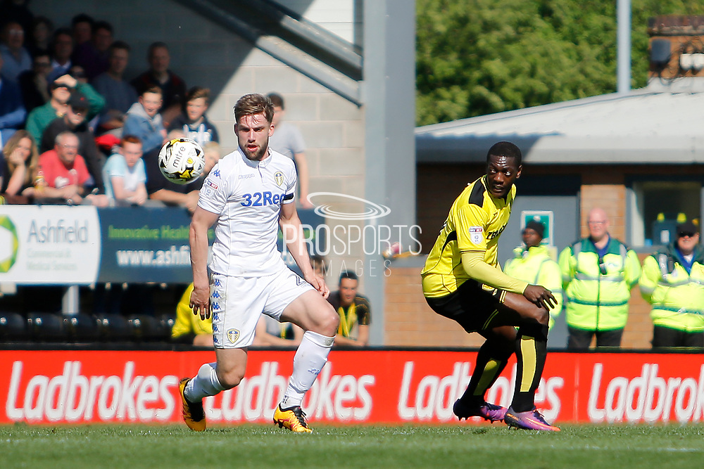 Leeds United defender Charlie Taylor (21) and Burton Albion striker Marvin Sordell (9) during the EFL Sky Bet Championship match between Burton Albion and Leeds United at the Pirelli Stadium, Burton upon Trent, England on 22 April 2017. Photo by Richard Holmes.