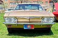 April 28, 2013 - Floral Park, New York, U.S. -  A World's Fair 1964 1965 plate is on the front of DON PEZZOLLA's 1964 Chevy Corvair 140, at the Antique Auto Show, where New York Antique Auto Club members exhibited their cars on the farmhouse grounds of Queens County Farm Museum. Pezzolla explained that 1964 and 1965 were the only two years New York didn't require front license plates, because of the World's Fair in Queens.