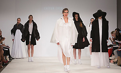 © Licensed to London News Pictures. 30/05/2015. London, UK. A model walks the runway during the Birmingham City University fashion show at Graduate Fashion Week 2015 wearing the collection of graduate student Caiyun Chen. Graduate Fashion Week takes place from 30 May to 2 June 2015 at the Old Truman Brewery, Brick Lane. Photo credit : Bettina Strenske/LNP