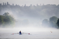© Licensed to London News Pictures. 24/05/2021. Henley-On-Thames, UK. A rower makes her way through a mist covered landscape in the early morning on the River Thames at Henley-on-Thames in Oxfordshire . Photo credit: Ben Cawthra/LNP