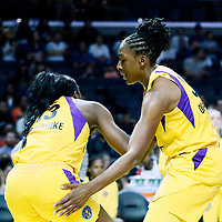 LOS ANGELES, CA - JUN 30: Nneka Ogwumike (30) of the Los Angeles Sparks helps Chiney Ogwumike (13) of the Los Angeles Sparks to stand up during a game on June 30, 2019 at the Staples Center, in Los Angeles, California.