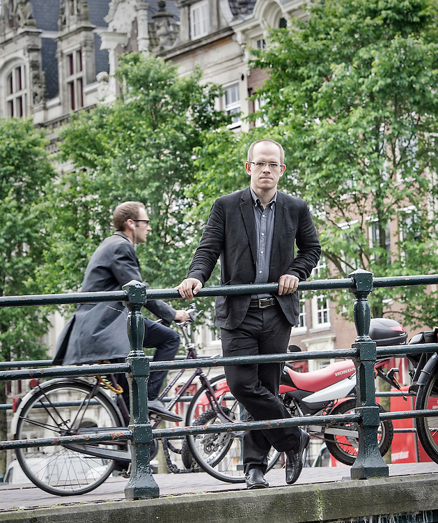 Netherlands. Amsterdam, 26-05-2014. Photo: Patrick Post.  Portrait of Evgeny Morozov, a contributing editor at The New Republic and the author of The Net Delusion: The Dark Side of Internet Freedom and To Save Everything, Click Here: The Folly of Technological Solutionism.