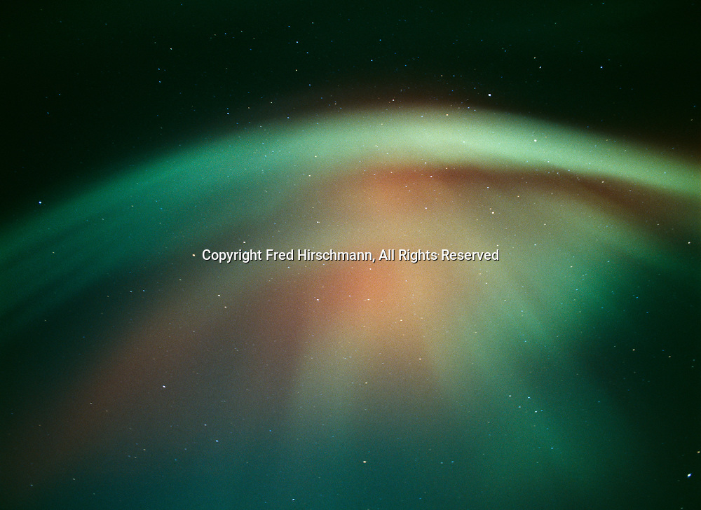 View of green and red aurora corona during geomagnetic storm on the night of October 27-28, 2001, Upper Susitna Valley, Alaska.