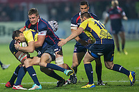 Louis Stanfill (C) of USAtries to stop Robert Neagu (L) of Romania  during their  rugby test match between Romania and USA, on National Stadium Arc de Triomphe in Bucharest, November 8, 2014.  Romania lose the match against USA, final score 17-27.