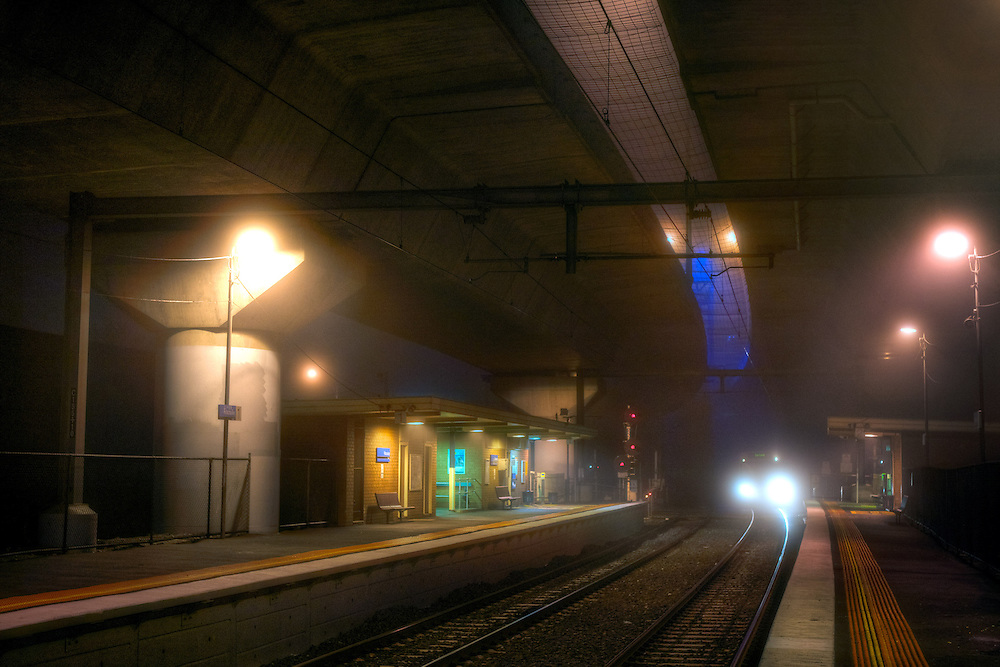 Scary Railway Stations at night. About 9:30 Outbound train approaches the platform at Macaulay railway station under heavey fog. The station is built under the CityLink Tollway. Pic By Craig Sillitoe CSZ/The Sunday Age/The Age iPad App.28/06/2011 This photograph can be used for non commercial uses with attribution. Credit: Craig Sillitoe Photography / http://www.csillitoe.com<br /> <br /> It is protected under the Creative Commons Attribution-NonCommercial-ShareAlike 4.0 International License. To view a copy of this license, visit http://creativecommons.org/licenses/by-nc-sa/4.0/.