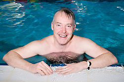 Man in the swimming pool at his local leisure centre,