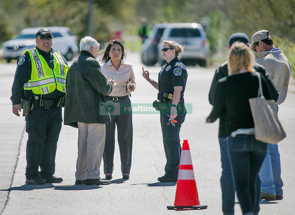 Austin Police PIO representatives talk to the media at FedEx Ground facility located at 4117 McKinney Falls Parkway Tuesday morning March 20, 2018 for a suspicious package that could be tied to the recent Austin bombings and the earlier bomb that was detonated at a FedEd facility in Schertz, Texas. Photo by Ralph Barrera/Austin American-Statesman/TNS/ABACAPRESS.COM